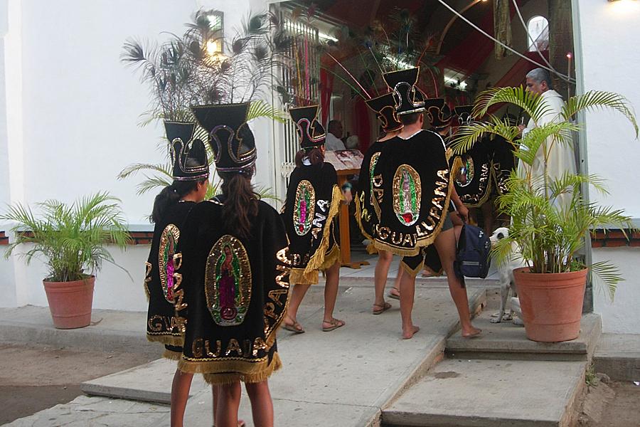 Entering the church during fiestas patronales in la Cruz de Huanacaxtle